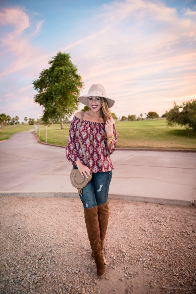 off-the-shoulder-top-over-the-knee-boots-chloe-crossbody-bag-distressed-denim-and-panama-hat-1