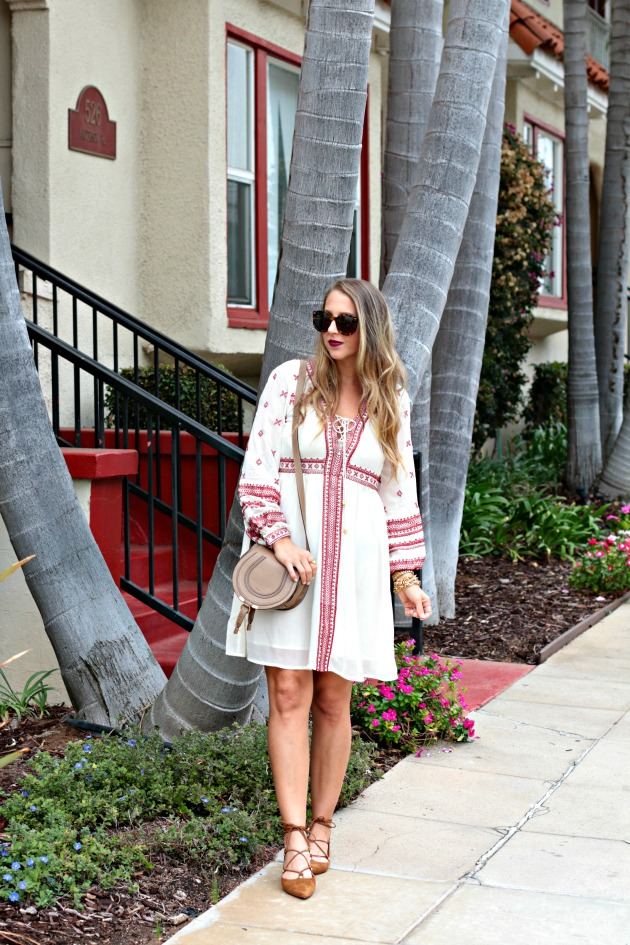 embroidered dress, lace ups and cross body bag