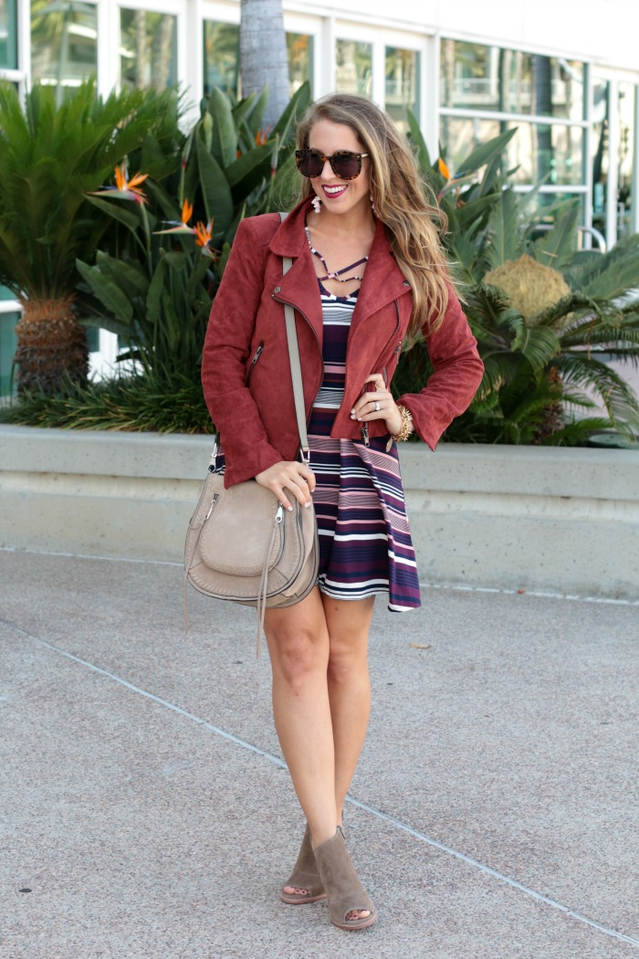 striped-cross-front-dress-booties-moto-jacket-tassels-earrings-and-rebecca-mink-saddle-bag-3