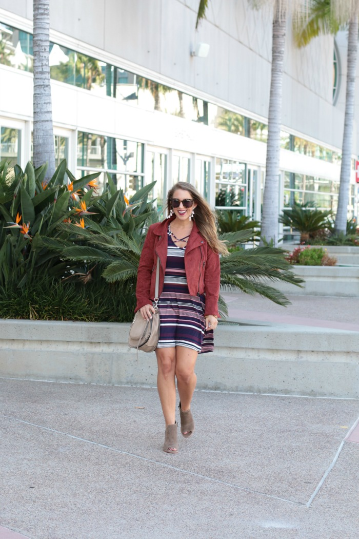 striped-cross-front-dress-booties-moto-jacket-tassels-earrings-and-rebecca-mink-saddle-bag-5