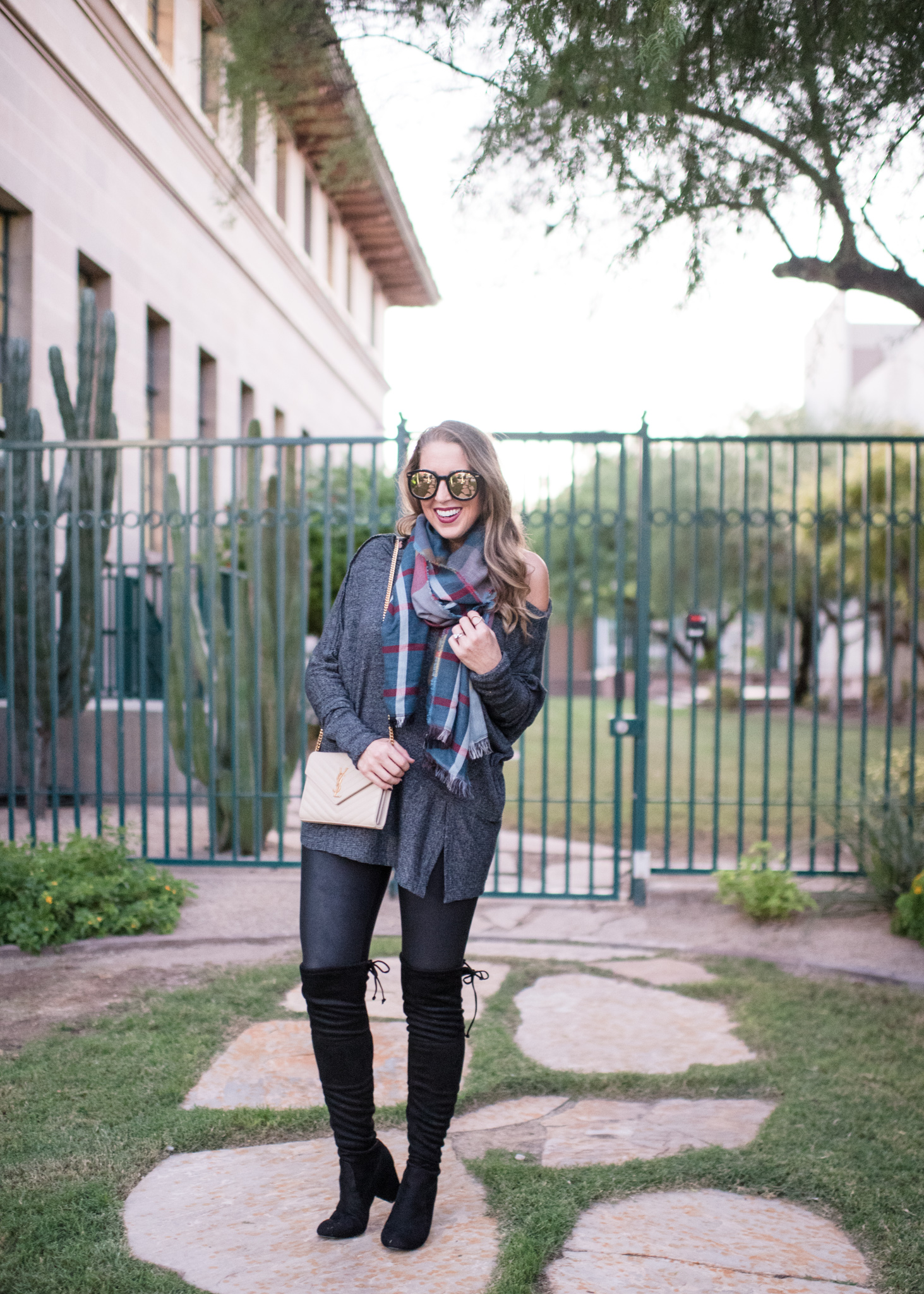 Free people tunic, plaid scarf, over the knee boots and YSL bag
