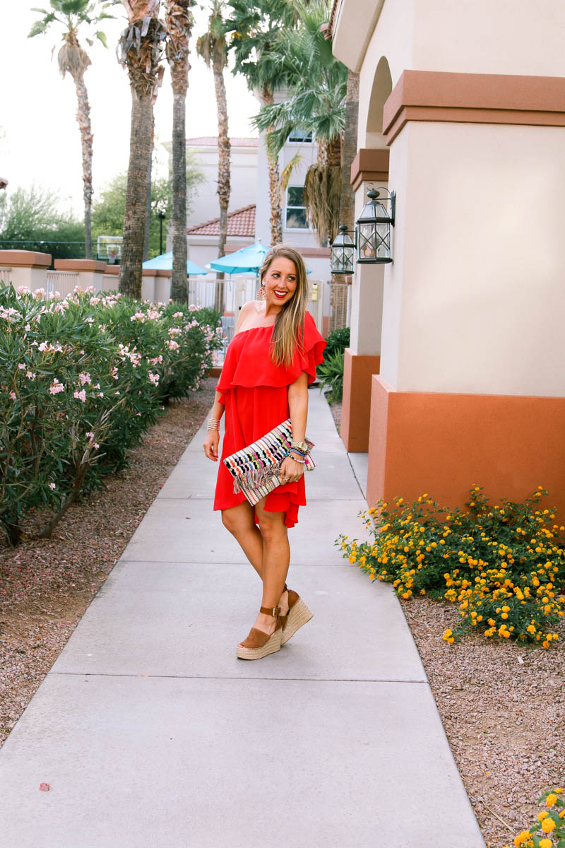 Red Ruffle off the shoulder dress, tassel clutch and wedges