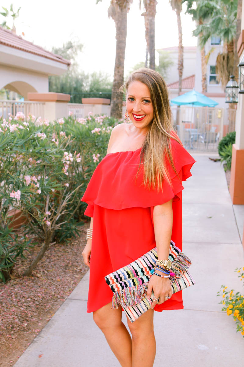 Red Ruffle off the shoulder dress and tassel clutch