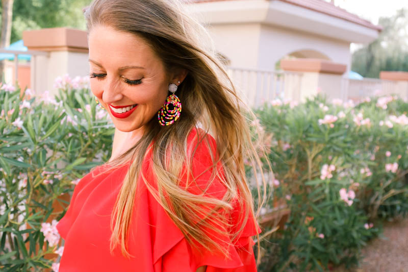 statement earrings and red ruffle off the shoulder dress