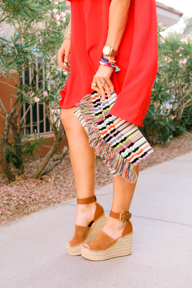 Wedges, tassel clutch and red ruffle off the shoulder dress